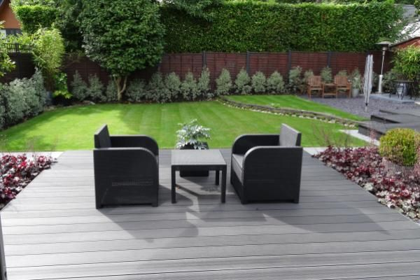 Cladco WPC Decking Boards in Charcoal Colour - were used to create this outside seating area. www.wpc-decking.co.uk