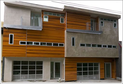 The combination of natural, stained wood with man-made, hard concrete works really, really well together.Modern Home