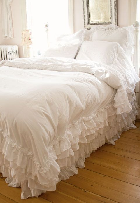This is a white cotton blend Queen duvet with 3 layers of 6' ruffles with a smaller mini ruffle at the top of the ruffles.
