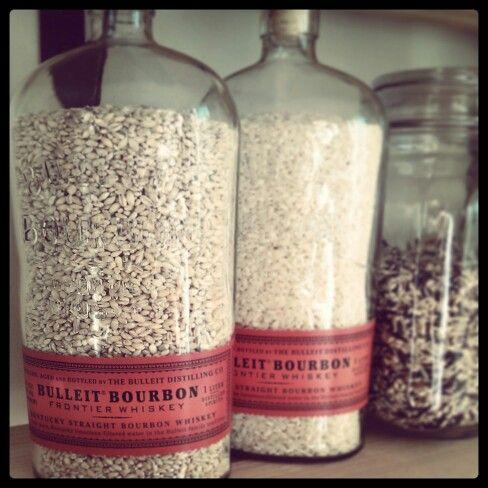 Using empty liquor bottles for grain storage