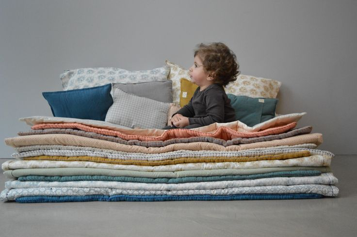 The prince and the pea. Layer up on hand quilted blankets and pillows by Camomile london.