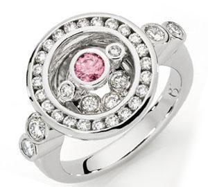 Circle ring with one natural Australian pink diamond & white round brilliant cut diamonds