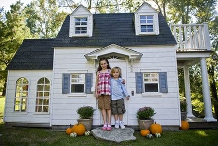 Playhouse with simulated hardwood floors, electricity, and a sleeping loft.