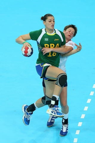 Eduarda Amorims of Brazil competes for the ball with Lyn Byl of Great Britain in the Women's Handball Preliminaries Group A match between Great Britain and Brazil on Day 5 of the London 2012 Olympic Games at The Copper Box on August 1, 2012 in London, England. (Photo by Jeff Gross/Getty Images)