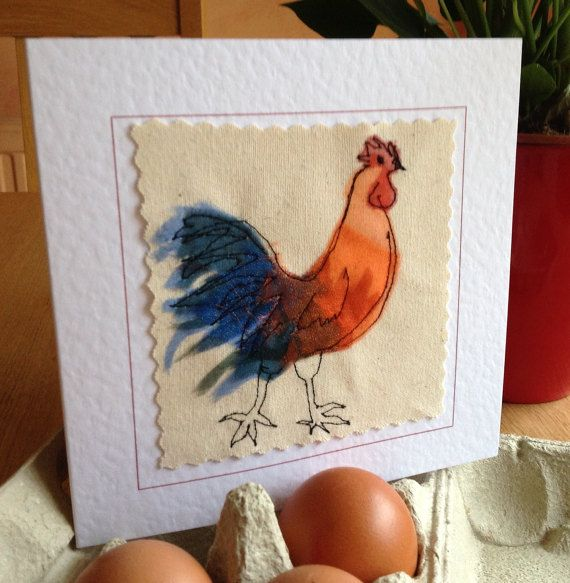 This colourful, stunning rooster was made by sewing layers of organza onto a canvas background. The finished result is similar to that of a painted picture but far more special and unique. The needle was my pen and the fabric was my paint. It has to be held in the hand to be fully appreciated. This card would shine out from any others in a line up. It would be perfect for framing as a special memento to keep long after the event. Each card is individually handmade by me in my studio so small…
