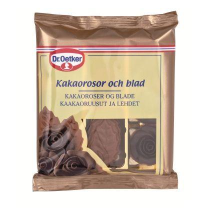 Kakaorosor och blad Dekorera din tårta eller bakelse med vackra rosor och blad tillverkade i mjuk sockermassa färgad i kakao. En förpackning Dr. Oetker Kakaorosor och blad innehåller 6 st kakaofärgade rosor och 12 st kakaofärgade blad.