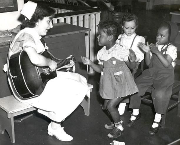 Louisa Urey Murray, class of 1954 Yale School of Nursing, later a public health nurse in Fairfax County, Virginia, devoted the elective month during her senior year at to a project in music therapy for the hospitalized children. Photo by Alburtus-Yale News Bureau, 1954.