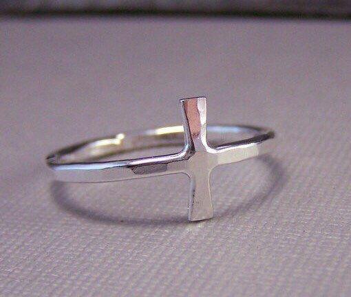 A personal favorite from my Etsy shop https://www.etsy.com/listing/60102135/silver-cross-ring-sideways-cross-jewelry