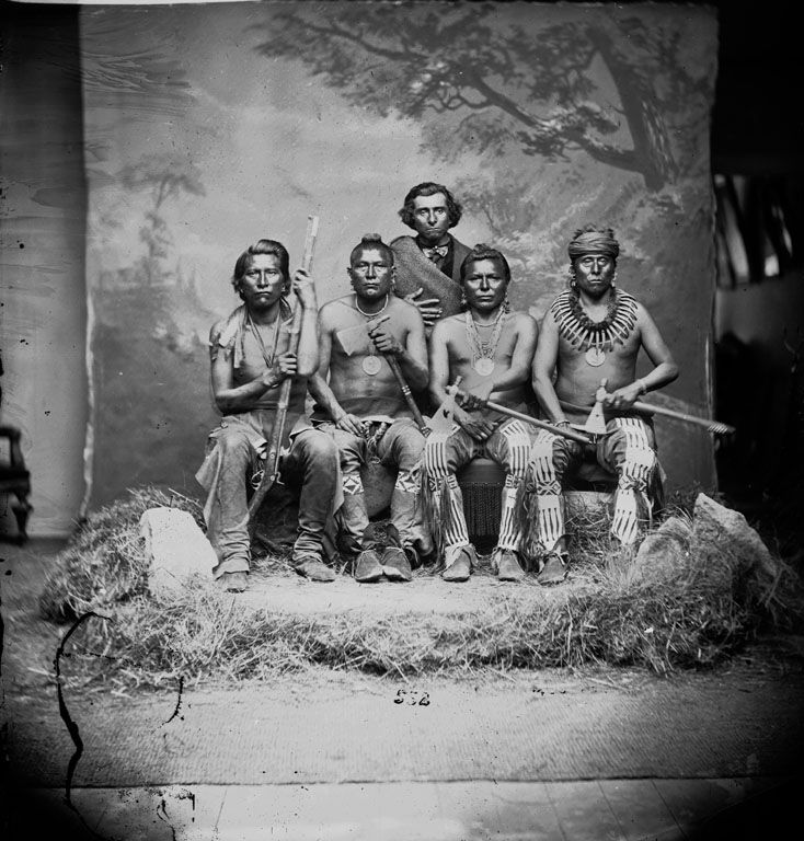 Standing: Baptiste Bayhylle (aka The Heavens See Him As A Chief, Pawnee/French interpreter) Sitting L-R: Man Who Left His Enemy Lying In The Water, His Chiefly Night (aka Night Chief), One Who Strikes The Chiefs First, Sky Chief - Pawnee - 1868