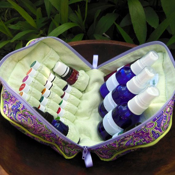 Natural Essential Oil Travel Bag  I like the concept of this carrying case with space for various size bottles!