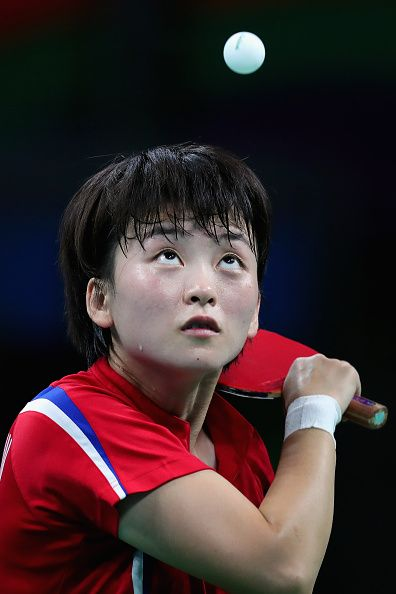 Myong Sun Ri of North Korea competes against Ai Fukuhara of Japan during Round 4 of the Women's Singles Table Tennis on Day 3 of the Rio…
