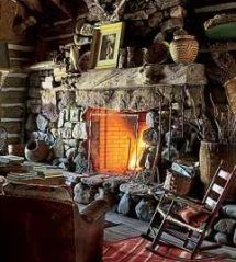 love this warm and toasty stone hearth.....  log cabin fireplace