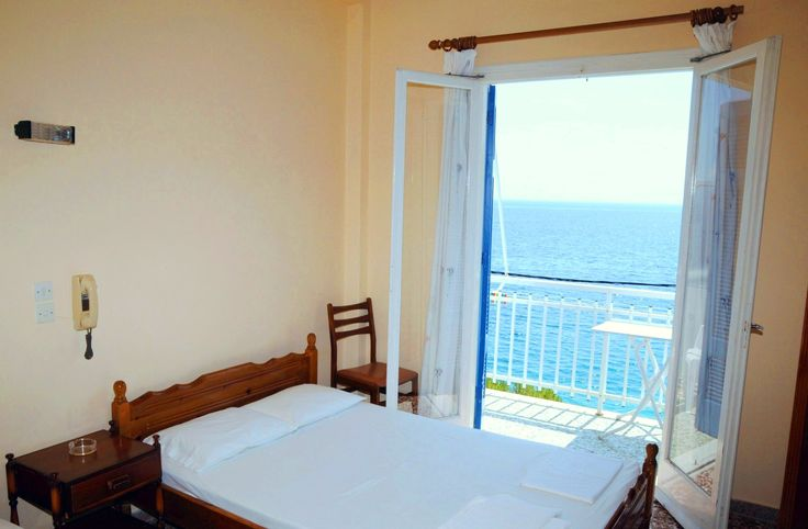 One of our Hotel's Rooms with a fantastic view to the Myrtoan Sea. Location: Peloponnese Greece - Tyros town