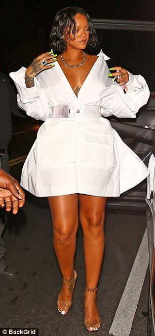 Floaty number: Rihanna cinched in her waist with a see-through plastic belt, as the bottom of the dress splayed out