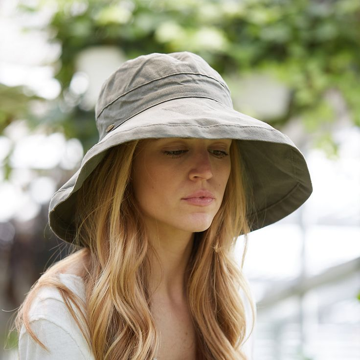 "Handmade from lightweight and breathable cotton, this colorful crusher hat is perfect for a day at the beach or in the garden. Packable construction pairs with UPF 50 sun protection and an inner drawstring to assure a comfortable fit.- Cotton- Spot clean- Imported23"" crown, 5"" brim"