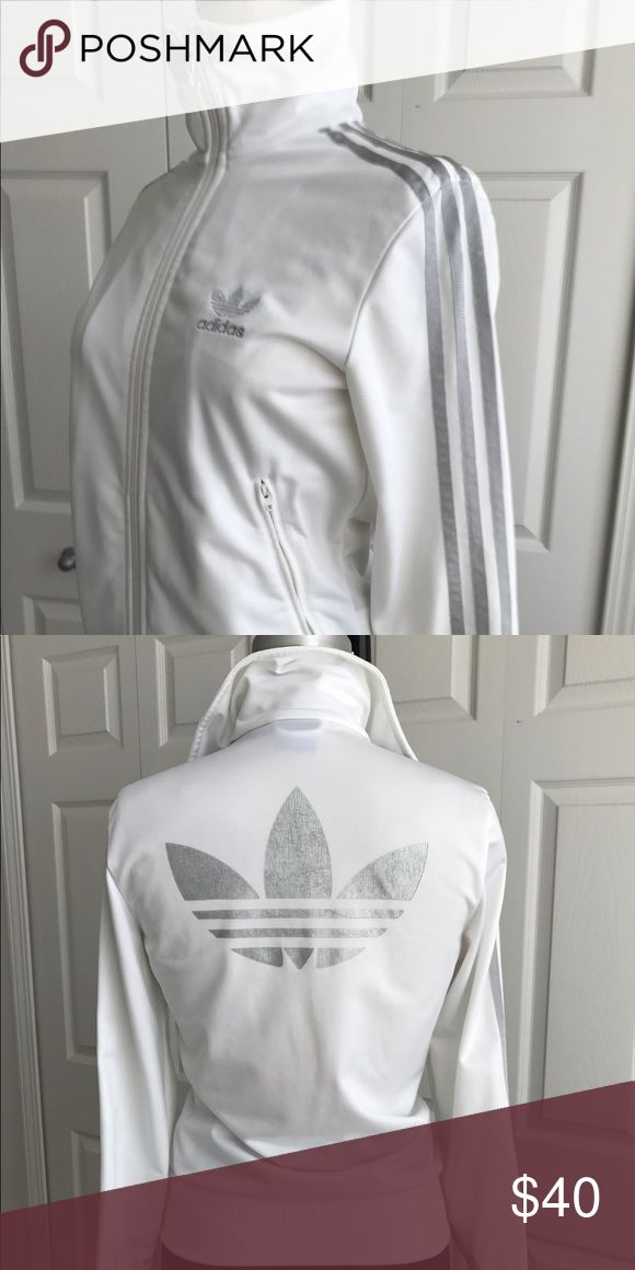 Adidas White Zip Up Adorable zip-up from Adidas. Worn twice and never wore again! In perfect condition adidas Tops Tees - Long Sleeve
