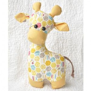 Cute stuffed giraffe! This downloadable giraffe sewing pattern is available for $9. It says there is minimal hand sewing, making it convenient for gift-giving.   It stands about a foot high.
