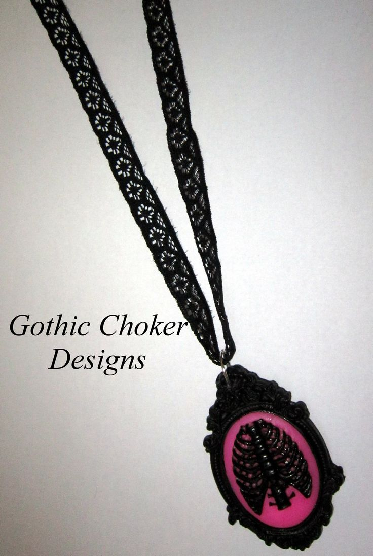 Black lace necklace with black and pink ribcage cameo. R120 approx $12.  Purchase here:https://hellopretty.co.za/gothic-choker-designs/black-lace-necklace-with-pink-ribcage