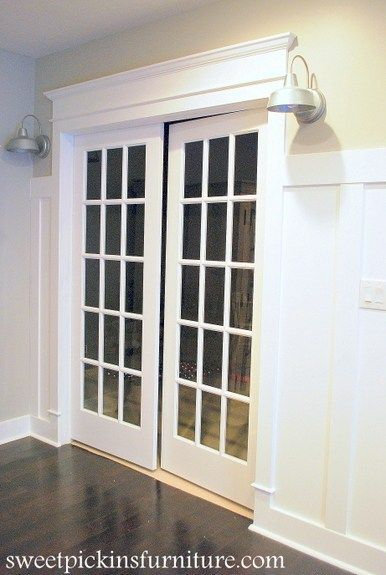 """For the entrance into our """"casino"""" room, we wanted the molding to be a little more grand. We added the lights to each side of the door, but still needed something more to make that ent…"""