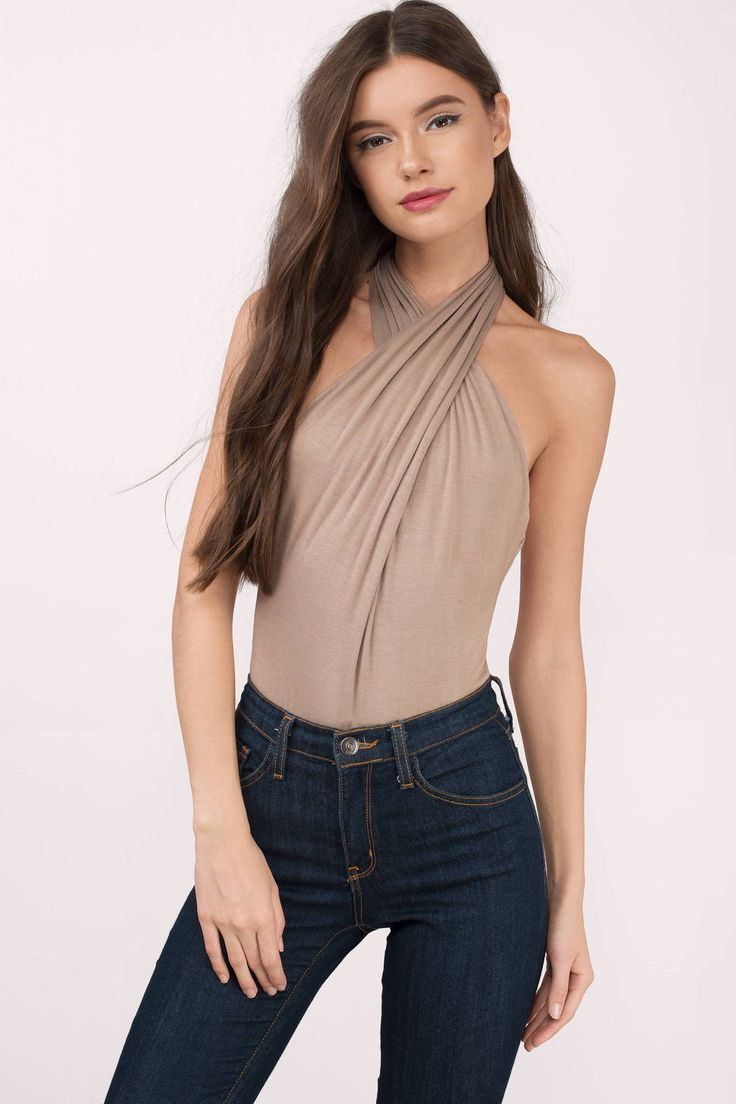 Be daring with the Zaira Wrap Halter Bodysuit. Featuring a wrap front detail and halter neckline. Pair with a skirt and heeled sandals.
