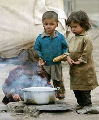 Refugee Children Making Food