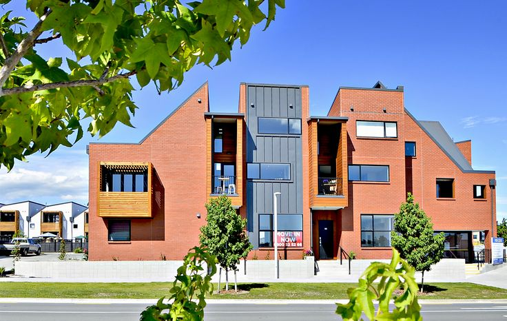 Striking red-brick finish to these modern terraced houses in the new Auckland development at Hobsonville Point