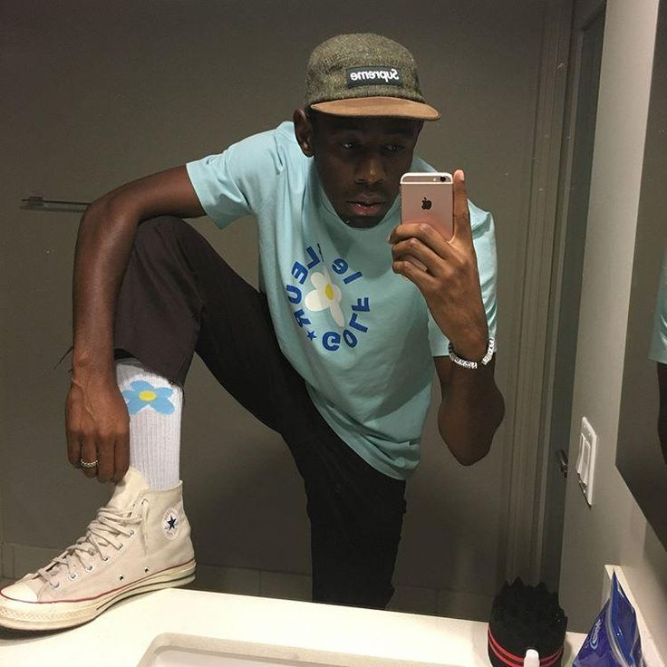 Tyler, The Creator shows his style wearing his white All Stars by Converse