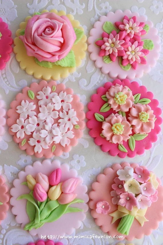 http://www.etsy.com/uk/listing/154038471/flower-fondant-cupcake-toppers-12?ref=shop_home_active