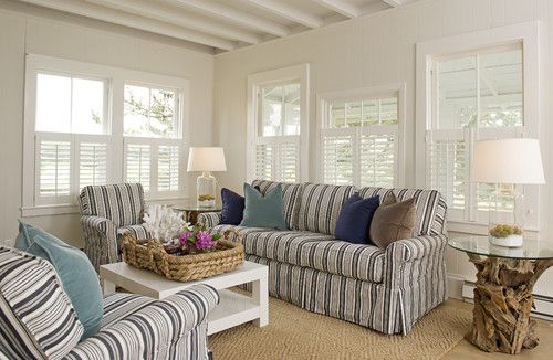 """""""Breezy luminous beach cottage atmosphere... love the cafe style plantation shutters and beams overhead. Love the bright white with the blue"""""""