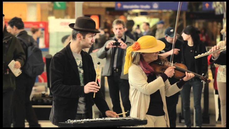 Flashmob Carmina Burana, via YouTube.   Soloists, Choir, Orchestra of the Vienna Volksoper offered to passengers and passers-by a special performance - Westbahnhof, Wien 2012 April  http://www.volksoper.at  http://www.ppmzweinull.com/ppmzweinul...