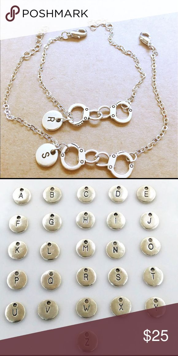 Two partners in crime charm bracelets Silver plated material. Comes in two bracelets. Let me know your initials Jewelry Bracelets