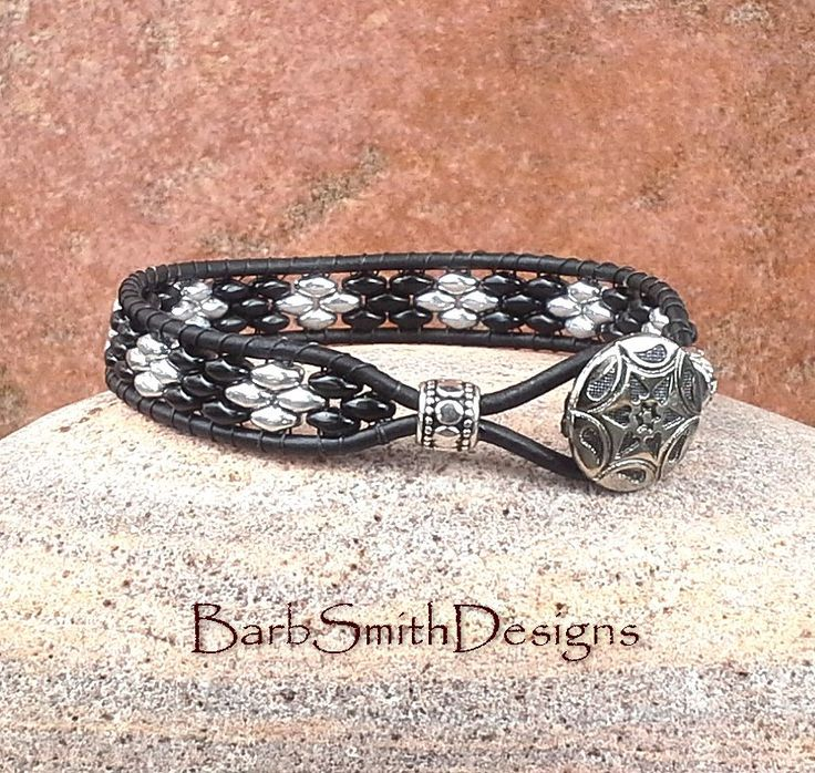 The Skinny One in Black  This slender single-wrap beaded cuff bracelet features black and silver beads on black leather cord. The closure is a 5/8 antique silver southwest button and single leather loop, accented with silver spacer beads on each side. This bracelet is available in various wrist sizes: 5 1/2 5 3/4 6 6 1/4 6 1/2 6 3/4 7 7 1/4 7 1/2 8  Bracelet width: 3/8  Please choose your exact wrist size at checkout - a little extra has been added for comfort and fastening. (Bead pattern…
