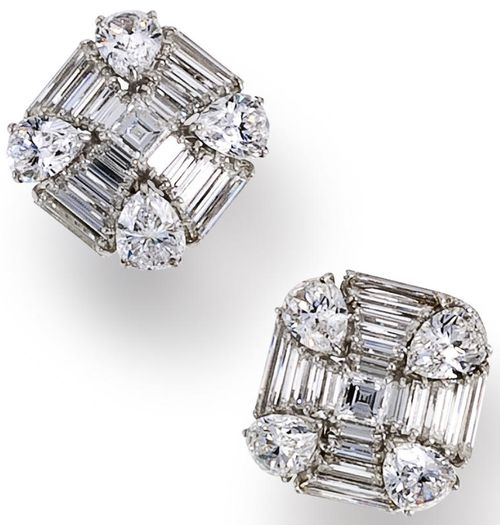 A pair of diamond earclips, Harry Winston, 1989 and 1998.     Each centering a square step-cut diamond, surrounded by rows of diamond bagettes and by four pear-shaped diamonds; signed Winston, with maker's mark for Jacques Timey for Harry Winston, with signed box; total diamond weight: 16.63 carats; mounted in platinum; length: 3/4in. (one earclip replaced by Winston). Via Bonhams.