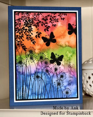 By Ank. Apply drops of reinker to wet watercolor paper. Then flick a wet toothbrush all over the piece until you like the look. Dry completely. Use black StazOn for the silhouette stamps: tree branch, flowers, butterflies.