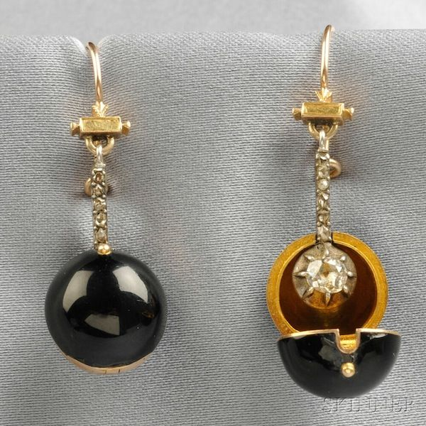 """Late 18th century diamond earrings with """"coach covers"""". The small black spheres snapped over the diamonds for daytime wear or to camouflage while traveling."""