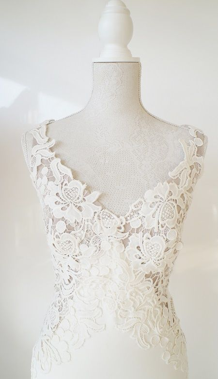 """Scuba wedding gown withan elegant lace bodice and open back.      Hire R7500    [call_two href=""""http://my.setmore.com/bookingpage/d355730c-585c-4a09-b166-240ebc71e9cc"""" colortext=""""#afafaf"""" background_color=""""#ffffff"""" font_size=""""32"""" label_button=""""Book appointment"""" label_size=""""30"""" class=""""call-to-action-two"""" animation_delay=""""0"""" animate="""""""" ][/call_two]"""