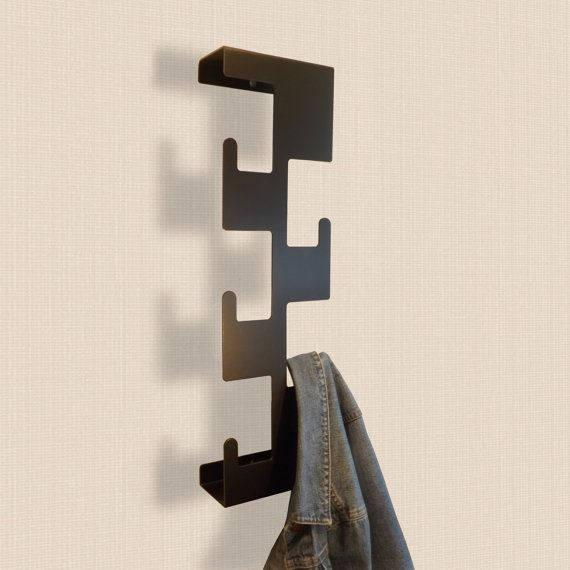 This functional piece of wall art hold coats and jackets in a very clever space saving way.  Additional shelf is incorporated to hold keys, mobiles etc.  Each peak is designed to allow the hanging of your Jacket either by the loop or placing directly over the peak. With a capacity of up to 10 coats and jackets, together with a shelf behind for the storage of gloves, keys, glasses etc, the retro is a fantastic storage solution.  Made in UK from laser cut powder coated mild steel.  The Retro…