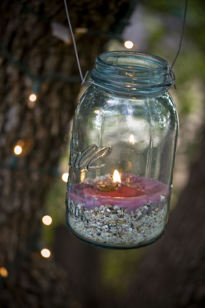 I love the way the pink of the candle looks next to the subtle blue tint of the mason jar - so pretty! Image by Logan Brumm (CC-BY-ND).
