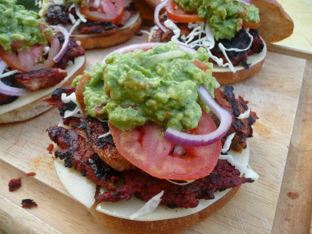 These are out of this world! I made these to take to the San Francisco Giants game today. Although the Giants didnt win, we left full and happy! The meat in these is very flavorful and gets a nice color from Achiote paste. From my favorite cookbook Baja: Cooking From the Edge.