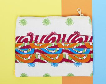 Four Times Strappy Clutch Bag. Add some colour to your outfit with this Ankara Cloth Clutch