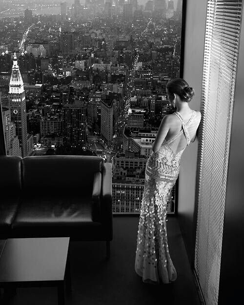 Such a beautiful and mysterious shot. The view is amazing and I wouldn't mind having that dress!