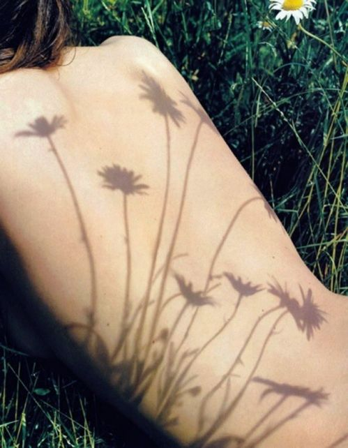 I love creative uses of shadows!  Could be fun for the hippie portraits this Summer :)