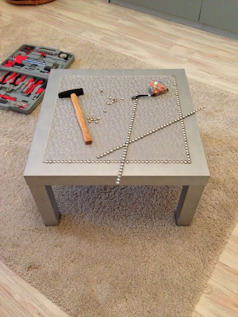 Silver coffee LACK table | IKEA Hackers-- modify this idea using colorful fabric for a kids room or decoupage a print/poster/whatever . .. and add the tacks .