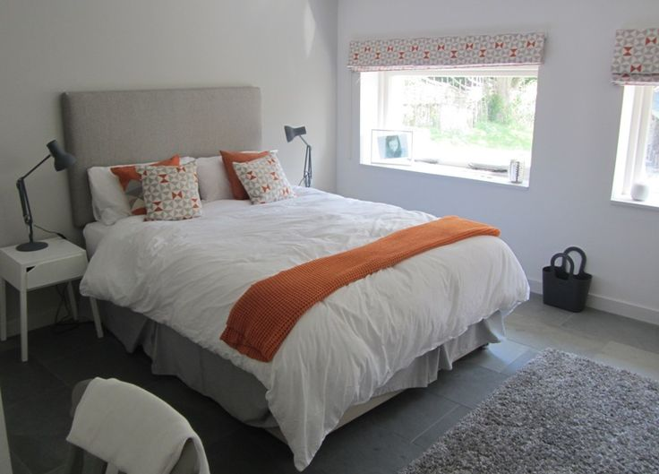 Orange accents inspired by interior brick walls elsewhere in this country home