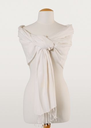Neutral is never boring with this handmade cream stole. Perfect on a spring night over a simple shift dress, or as a wrap at a fall wedding, it's the go-to accessory of the season.