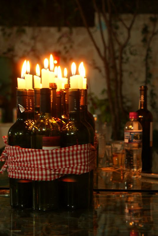 Gaaya Spice: Choro e vela // looks like a fire waiting to happen but I adore the grouping of the bottles & candles too