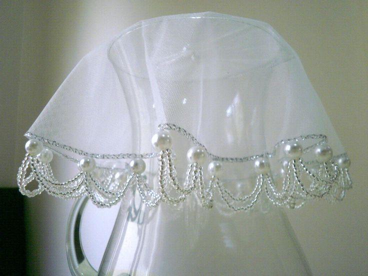 Cobre jarras com tecido em organza de 25 cms bordado com pérolas e miçangas de cristal.    Acima de 3 unidades, ganhe desconto de 5%.