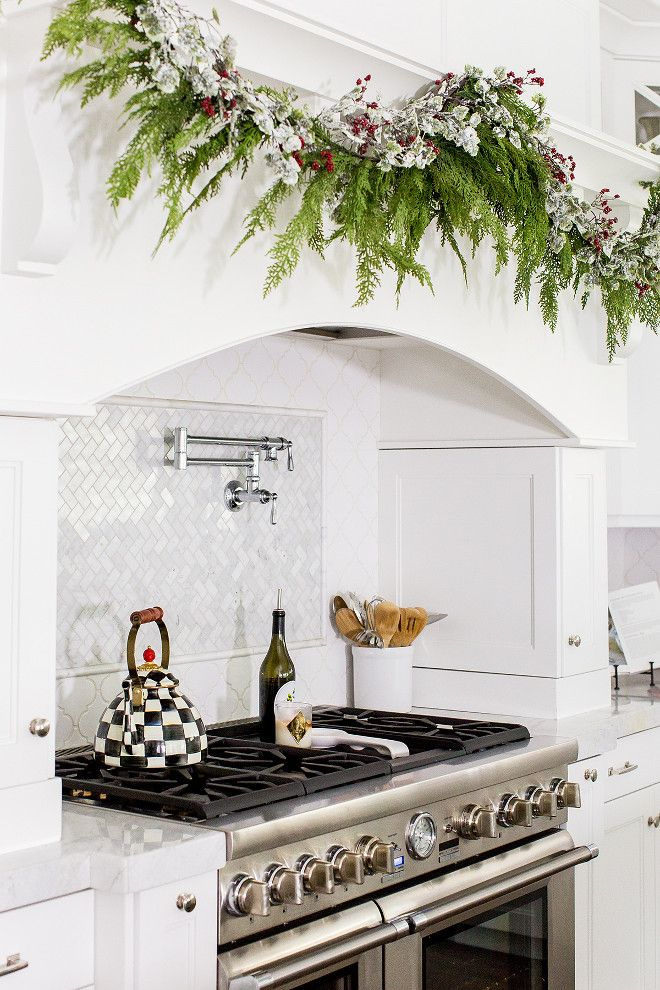 I like the way this stove is framed with thin cabinetry (possible for use for spices and spatulas, etc? Also like the pot filler and the white wood hood.
