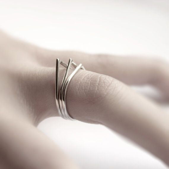 MIRTA, THORNS: three sterling silver stacking rings.