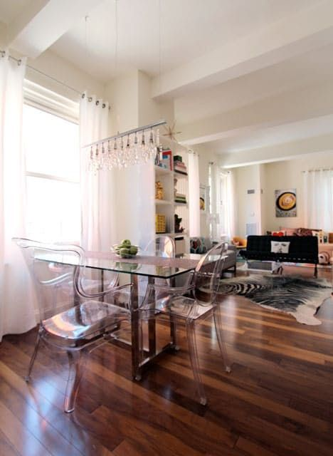Love this organization of a long living room: Dining room -> (Adult) Living room -> Playroom (With twin/daybed + pull down privacy curtain)